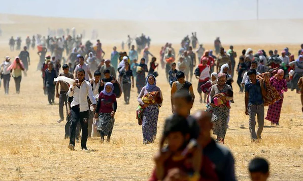 Yezidis trapped in the Sinjar mountains being rescued in 2014. Photo GETTY IMAGES